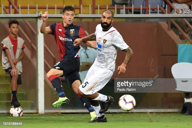 Krzsysztof Piatek of Genoa and Francesco Cosenza of Lecce during the Coppa Italia match between Genoa CFC and Lecce at Stadio Luigi Ferraris on...