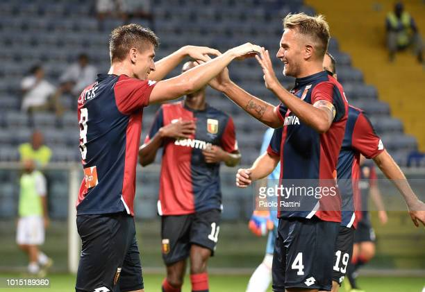 Krzsysztof Piatek of Genoa celebrate with Domenico Criscito during the Coppa Italia match between Genoa CFC and Lecce at Stadio Luigi Ferraris on...