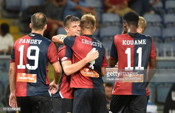 Krzsysztof Piatek of Genoa celebrate with teammates after scoring during the Coppa Italia match between Genoa CFC and Lecce at Stadio Luigi Ferraris...
