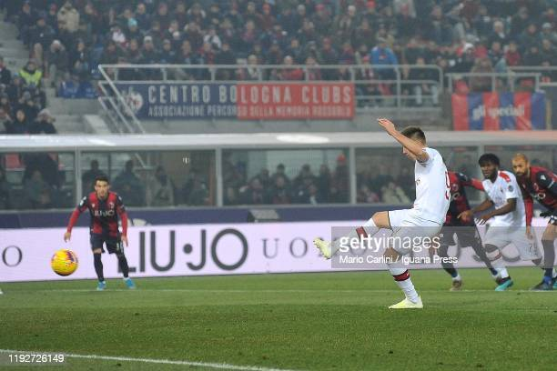 Krzystof Piatek of AC Milan scores the opening goal from the penalty spot during the Serie A match between Bologna FC and AC Milan at Stadio Renato...