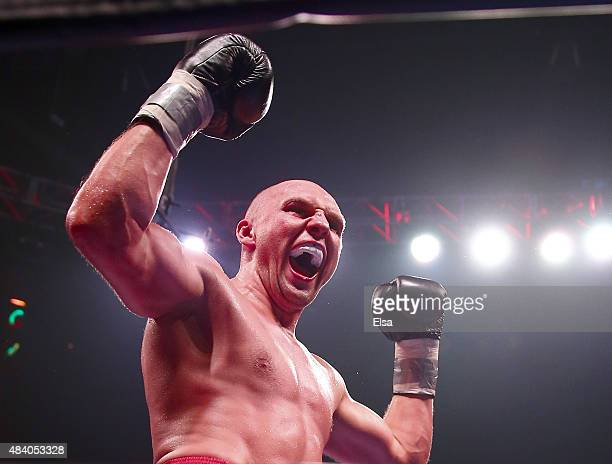 Krzysztof Glowacki of Poland celebrates after defeated Marco Huck of Germany during the Premier Boxing Champions Cruiserweight bout at the Prudential...
