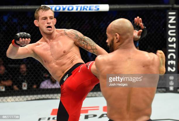 Krzysztof Jotko kicks David Branch in their middleweight fight during the UFC 211 event at the American Airlines Center on May 13 2017 in Dallas Texas