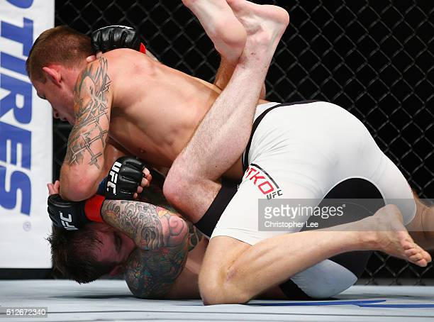 Krzysztof Jotko of Poland battles with Bradley Scott of England during the Middleweight Bout of the UFC Fight Night at The O2 Arena on February 27...