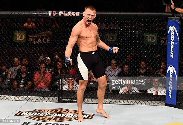 Krzysztof Jotko of Poland celebrates his knockout victory over Tamdan McCrory in their middleweight bout during the UFC Fight Night event inside the...