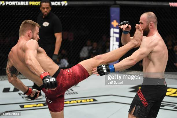 Krzysztof Jotko of Poland kicks Alen Amedovski of Macedonia in their middleweight bout during the UFC Fight Night event at Yubileyny Sports Palace on...
