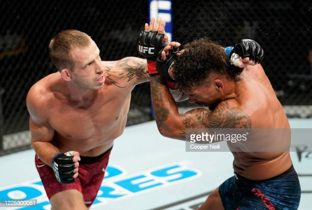 Krzysztof Jotko of Poland punches Eryk Anders in their middleweight fight during the UFC Fight Night event at VyStar Veterans Memorial Arena on May...