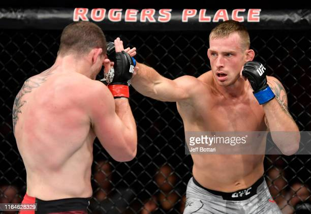 Krzysztof Jotko of Poland punches MarcAndre Barriault of Canada in their middleweight bout during the UFC 240 event at Rogers Place on July 27 2019...