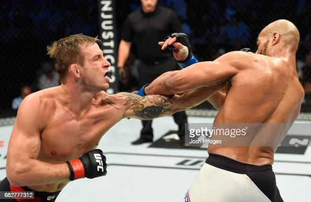 Krzysztof Jotko punches David Branch in their middleweight fight during the UFC 211 event at the American Airlines Center on May 13 2017 in Dallas...