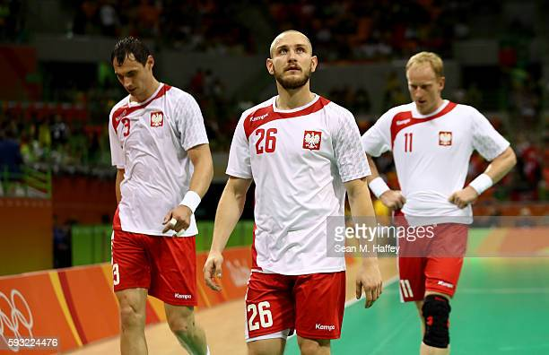 Krzysztof Lijewski Michal Daszek and Adam Wisniewski of Poland look dejected during the Men's Bronze Medal Match between Poland and Germany on Day 16...