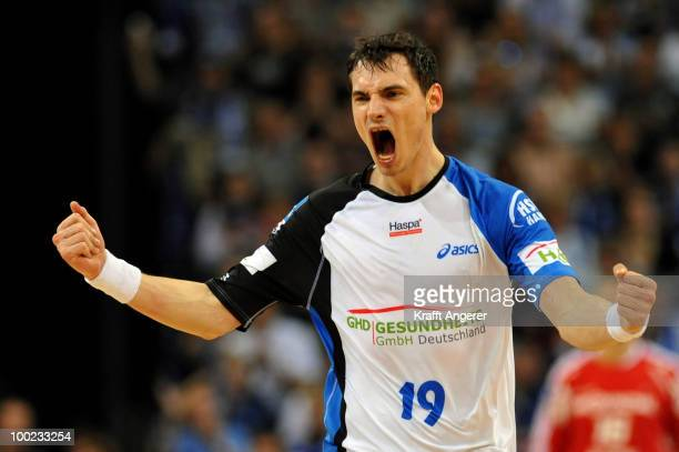 Krzysztof Lijewski of Hamburg celebrates during the Bundesliga match between HSV Hamburg and THW Kiel at the Color Line Arena on May 22 2010 in...