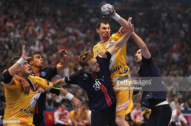 Krzysztof Lijewski of Kielce controls the ball during the first semifinal of the EHF Final4 between VS Tauron Kielce and Paris SaintGermain on May 28...