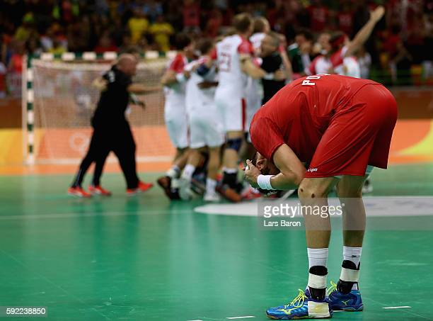 Krzysztof Lijewski of Poland looks dejected follwoing his team's defeat in the Men's Handball Semifinal match between Poland and Denmark on Day 14 of...