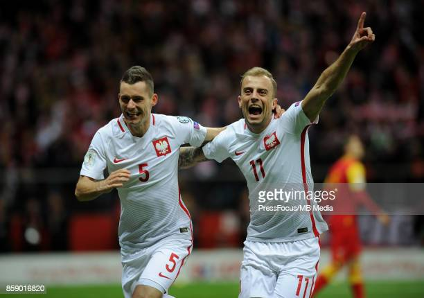 Krzysztof Maczynski of Poland celebrates with teammate Kamil Grosicki after scoring the opening goal during the FIFA 2018 World Cup Qualifier between...