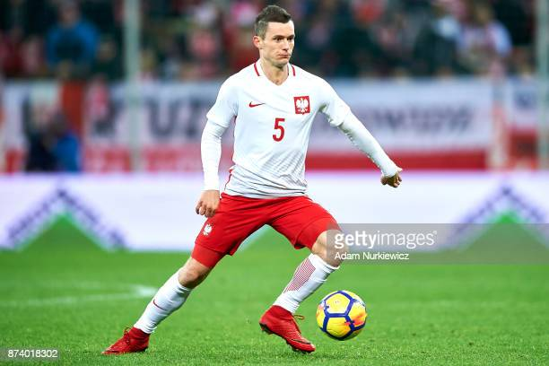 Krzysztof Maczynski of Poland controls the ball during the International Friendly match between Poland and Mexico at Energa Arena Stadium on November...