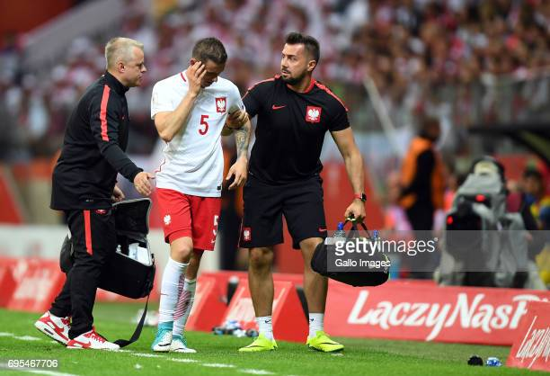 Krzysztof Maczynski of Poland injuried during the 2018 FIFA World Cup Russia eliminations match between Poland and Romania on June 10 2017 at the...