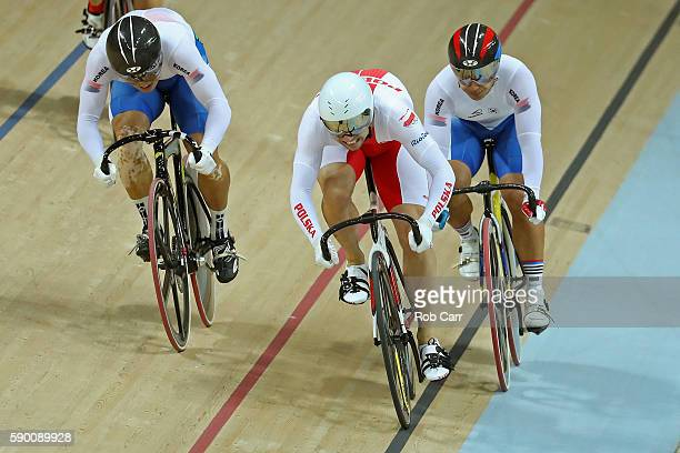 Krzysztof Maksel of Poland leads Chaebin Im of Korea and Dongjin Kang of Korea in the Men's Keirin First Round Repechages on Day 11 of the Rio 2016...