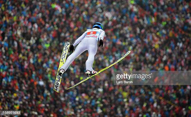 Krzysztof Mietus of Poland competes during the first round for the FIS Ski Jumping World Cup event of the 61st Four Hills ski jumping tournament at...