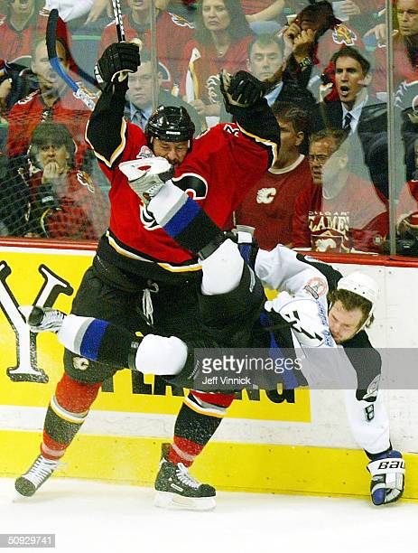 Krzysztof Oliwa of the Calgary Flames upends Martin Cibak of the Tampa Bay Lightning during the second period in game six of the NHL Stanley Cup...