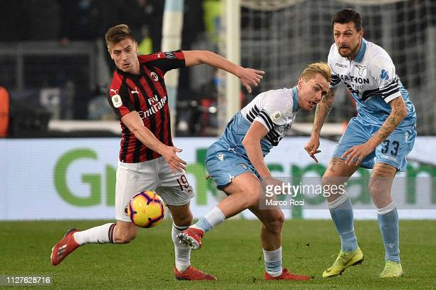 Krzysztof Piateck Suso of AC Milan compete for the ball with Patrico Gil Gabarron of SS Lazio during the Coppa Italia semifinal first leg between SS...