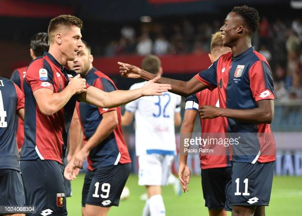 Krzysztof Piatek and Christian Kouame of Genoa celebrate after 10 during the serie A match between Genoa CFC and Empoli at Stadio Luigi Ferraris on...