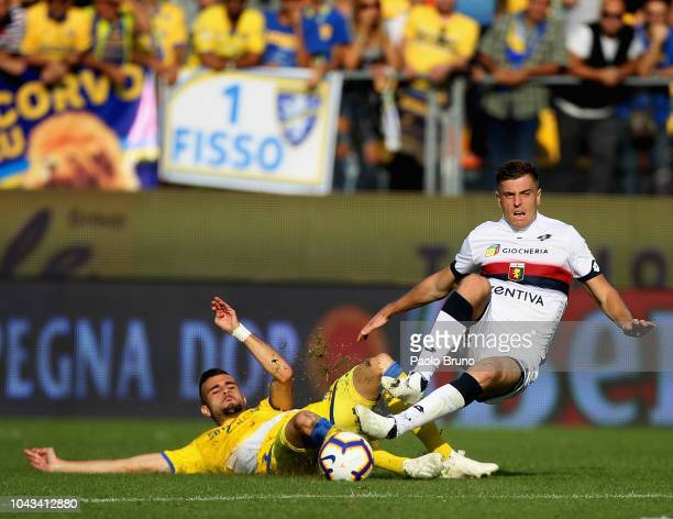 Krzysztof Piatek competes for the ball with Francesco Zampano of Frosinone Calcio during the Serie A match between Frosinone Calcio and Genoa CFC at...