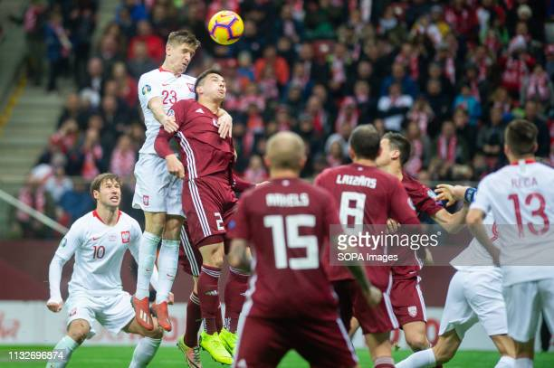 PGE NARODOWY WARSAW MASOVIA POLAND Krzysztof Piatek from Poland and Vitalijs Maksimenko from Latvia are seen in action during Euro 2020 Qualifiers...