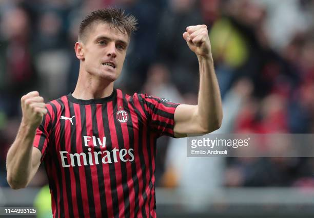 Krzysztof Piatek of AC Milan celebrates after scoring the opening goal during the Serie A match between AC Milan and Frosinone Calcio at Stadio...