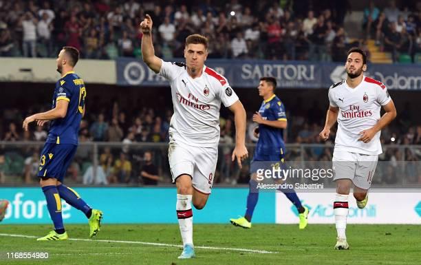 Krzysztof Piatek of AC Milan celebrates after scoring the opening goal during the Serie A match between Hellas Verona and AC Milan at Stadio...