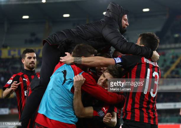 Krzysztof Piatek of AC Milan celebrates celebrates after scoring the second goal of his team with his teammates during the Serie A match between...