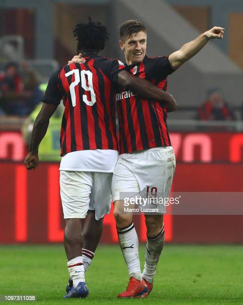 Krzysztof Piatek of AC Milan celebrates his goal with his teammate Franck Kessie during the Serie A match between AC Milan and Cagliari at Stadio...