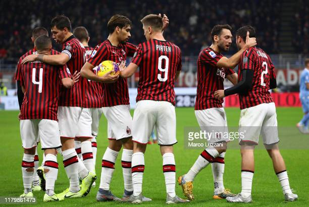 Krzysztof Piatek of AC Milan celebrates his goal with his team-mate Lucas Paqueta during the Serie A match between AC Milan and SS Lazio at Stadio...