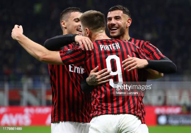 Krzysztof Piatek of AC Milan celebrates his goal with his teammate Theo Hernandez and Rade Krunic during the Serie A match between AC Milan and SS...