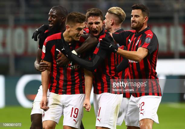 Krzysztof Piatek of AC Milan celebrates his second goal with his teammates during the Coppa Italia match between AC Milan and SSC Napoli at Stadio...