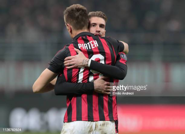 Krzysztof Piatek of AC Milan celebrates with his teammate Samuel Castillejo after scoring the opening goal during the Serie A match between AC Milan...