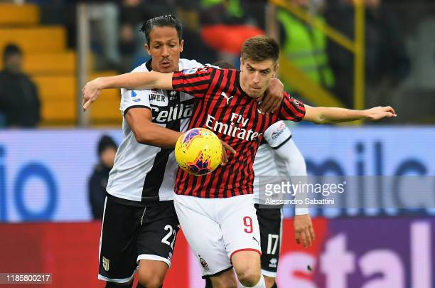 Krzysztof Piatek of AC Milan competes for the ball with Bruno Alves of Parma Calcio during the Serie A match between Parma Calcio and AC Milan at...