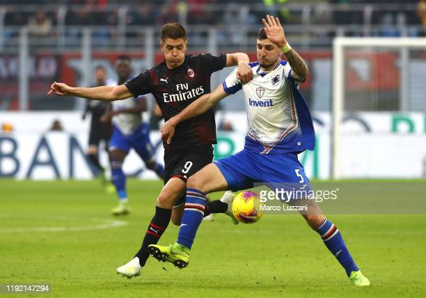 Krzysztof Piatek of AC Milan competes for the ball with Julian Chabot of UC Sampdoria during the Serie A match between AC Milan and UC Sampdoria at...