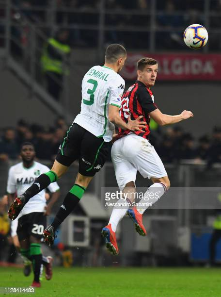 Krzysztof Piatek of AC Milan competes for the ball with Merih Demiral of Sassuolo during the Serie A match between AC Milan and US Sassuolo at Stadio...