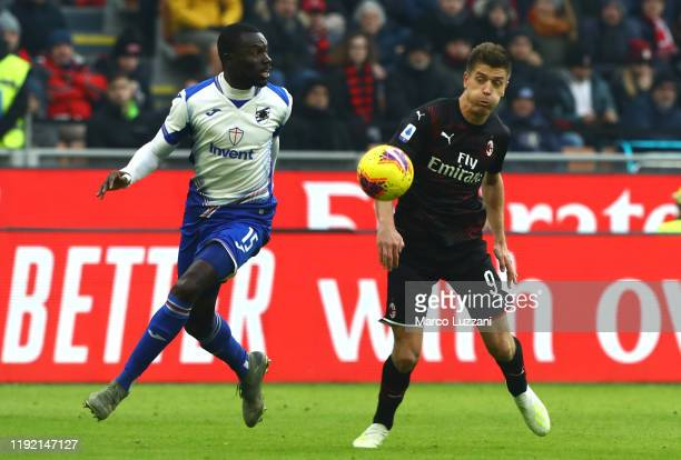 Krzysztof Piatek of AC Milan competes for the ball with Omar Colley of UC Sampdoria during the Serie A match between AC Milan and UC Sampdoria at...