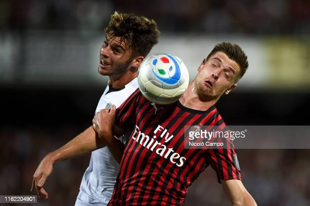 Krzysztof Piatek of AC Milan competes for the ball with Rosario Maddaloni of Cesena FC during the preseason friendly football match between Cesena FC...