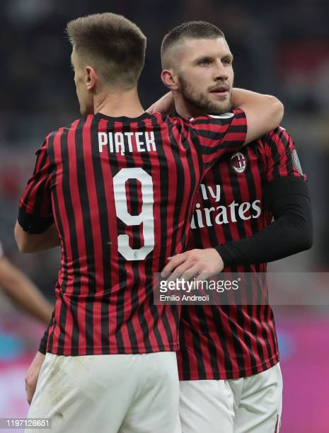 Krzysztof Piatek of AC Milan embraces his teammate Ante Rebic during the Coppa Italia Quarter Final match between AC Milan and Torino at San Siro on...