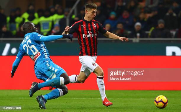 Krzysztof Piatek of AC Milan is challenged by Kalidou Koulibaly of SSC Napoli during the Serie A match between AC Milan and SSC Napoli at Stadio...