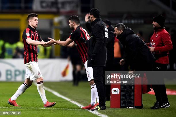Krzysztof Piatek of AC Milan is replaced by substitute Patrick Cutrone of AC Milan during the Coppa Italia quarterfinal football match between AC...
