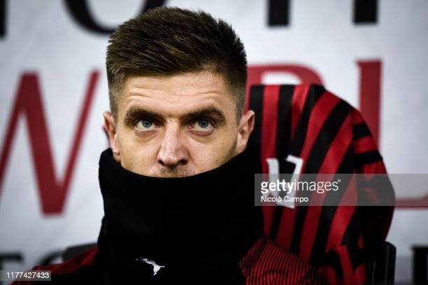 Krzysztof Piatek of AC Milan looks on as he sitting on the bench prior to the Serie A football match between AC Milan and US Lecce The match ended in...