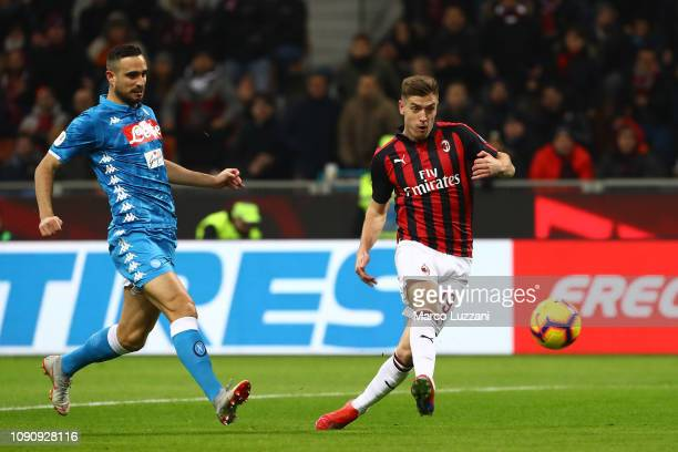 Krzysztof Piatek of AC Milan scores the opening goal during the Coppa Italia match between AC Milan and SSC Napoli at Stadio Giuseppe Meazza on...
