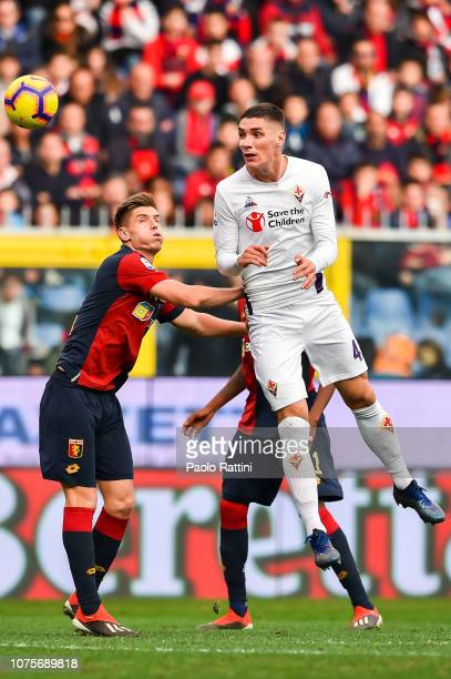 Krzysztof Piatek of Genoa and Nikola Milenkovic of Fiorentina vie for the ball during the Serie A match between Genoa CFC and ACF Fiorentina at...