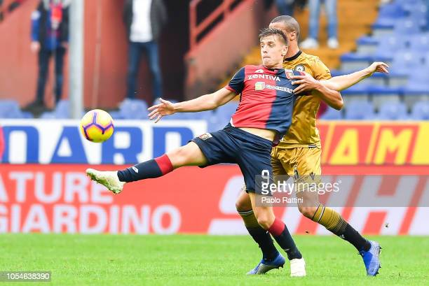 Krzysztof Piatek of Genoa and William Troost Ekong of Udinese vie for the ball during the Serie A match between Genoa CFC and Udinese at Stadio Luigi...