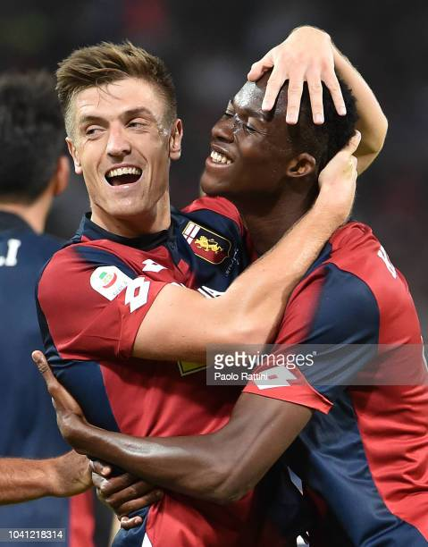 Krzysztof Piatek of Genoa celebrates with Christian KouamŽ after scoring 10 during the serie A match between Genoa CFC and Chievo Verona at Stadio...