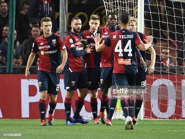 Krzysztof Piatek of Genoa celebrates with teammates after penalty 11 during the Serie A match between Genoa CFC and SPAL at Stadio Luigi Ferraris on...