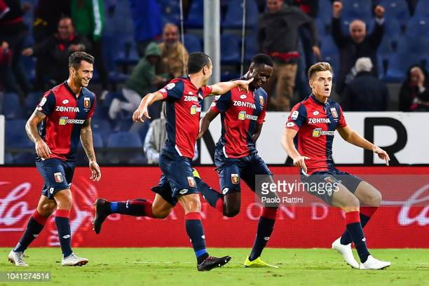 Krzysztof Piatek of Genoa celebrates with teammates after scoring 10 during the serie A match between Genoa CFC and Chievo Verona at Stadio Luigi...