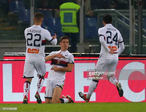 Krzysztof Piatek of Genoa CFC celebrates after scoring the opening goal during the Serie A match between AS Roma and Genoa CFC at Stadio Olimpico on...